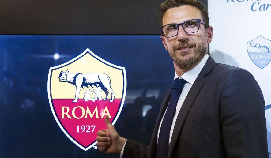 Newly named Roma head coach Eusebio Di Francesco poses for photos during a press conference at the team's Trigoria facility, in Rome, Wednesday, June 14, 2017. (Angelo Carconi/ANSA via AP)