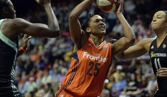 Connecticut Sun's Alyssa Thomas (25) splits the defense of New York Liberty's  Tina Charles, left, and Kiah Stokes during a WNBA basketball game, Wednesday, June 14, 2017 at Mohegan Sun Arena in Uncasville, Conn.. (Sean D. Elliot/The Day via AP)