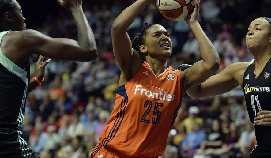 Connecticut Sun's Alyssa Thomas (25) splits the defense of New York Liberty's  Tina Charles, left, and Kiah Stokes during a WNBA basketball game, Wednesday, June 14, 2017 at Mohegan Sun Arena in Uncasville, Conn.. (Sean D. Elliot/The Day via AP)