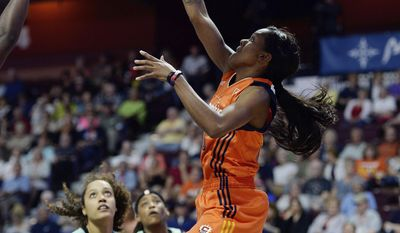 Connecticut Sun's Courtney Williams shoots a spinning reverse floater over the New York Liberty defense during a WNBA basketball game, Wednesday, June 14, 2017 at Mohegan Sun Arena in Uncasville, Conn.. (Sean D. Elliot/The Day via AP)