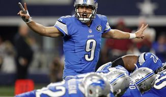 FILE - In this Dec. 26, 2016, file photo, Detroit Lions' Matthew Stafford (9) signals at the line of scrimmage in the first half of an NFL football game against the Dallas Cowboys in Arlington, Texas. Stafford is a new dad and yet insists thinking about his children's future isn't on his mind as he negotiates a new contract with the Detroit Lions. Stafford is entering the last season of his $53 million, three-year contract. He might be able to get more than the $140 million, six-year deal Andrew Luck signed last year with the Indianapolis Colts (AP Photo/Brandon Wade, File)