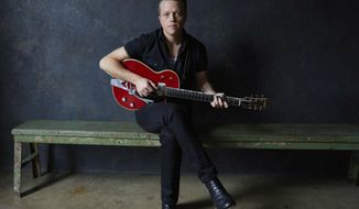 "This image released by All Eyes Media shows singer Jason Isbell, whose latest album, "" The Nashville Sound,"" was released this week. (Danny Clinch via AP)"