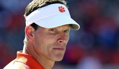 FILE - In this April 1, 2012, file photo, Clemson defensive coordinator Brent Venables watches his team warm up before a spring NCAA college football game in Clemson, S.C. No matter how much personnel turnover, Venables keeps putting top-notch defenses on the field for the Tigers. But he has found a perfect match at Clemson with Dabo Swinney, and he is making $1.7 million this year. He can afford to be patient. (Mark Crammer/The Independent-Mail via AP, File)