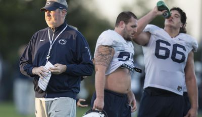 FILE - In this Oct. 5, 2016, file photo, Penn State offensive coordinator Joe Moorhead looks on during NCAA college football practice in State College, Pa. Moorhead was a successful FCS head coach at Fordham before being lured to Happy Valley by James Franklin. His first season with Penn State was a rousing success. (Joe Hermitt/PennLive.com via AP, File)