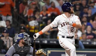 Houston Astros' Derek Fisher watches his solo home run off Texas Rangers relief pitcher Jeremy Jeffress during the sixth inning of a baseball game, Wednesday, June 14, 2017, in Houston. Fisher's home run is his first hit in the majors. (AP Photo/Eric Christian Smith)