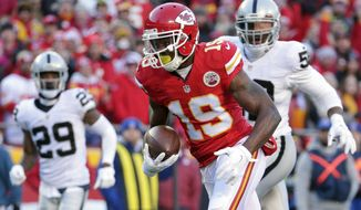 FILE - In this Jan. 3, 2016, file photo, Kansas City Chiefs wide receiver Jeremy Maclin (19) runs away from Oakland Raiders cornerback David Amerson (29) and defensive end Khalil Mack (52) during the first half of an NFL football game in Kansas City, Mo. Although the standout receiver put up lesser numbers last year than in 2015, Maclin had no indication he was about to be the victim of a salary-cap cut, especially after participating in offseason training activities with the Chiefs. Turns out, several NFL teams were interested in giving him a job. Baltimore proved to be the best fit, and Maclin happily signed a two-year deal on Monday, June 12, 2017. (AP Photo/Charlie Riedel, File)