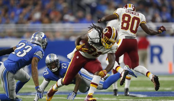 In this photo taken Oct. 23, 2016, Washington Redskins running back Matt Jones (31) rushes during the first half of an NFL football game against the Detroit Lions in Detroit. The agent for Jones hopes the Washington Redskins release the former starting running back sooner rather than later. (AP Photo/Paul Sancya)
