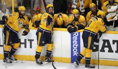 Nashville Predators' players react after their 2-0 loss to the Pittsburgh Penguins in Game 6 of the NHL hockey Stanley Cup Final, Sunday, June 11, 2017, in Nashville, Tenn. (AP Photo/Jeff Roberson)