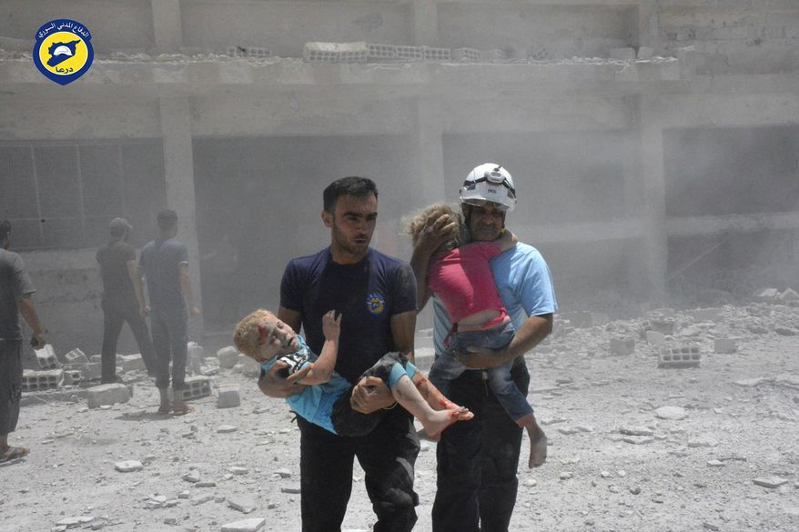 "This photo provided by the Syrian Civil Defense group known as the White Helmets, shows civil defense workers carrying children after airstrikes hit a school housing a number of displaced people, in the western part of the southern Daraa province of Syria, Wednesday, June 14, 2017. A U.N. investigative commission said Wednesday the ""de-escalation"" agreement in Syria has reduced violence in only one of four zones included in the deal and has not led to greater humanitarian access. (Syrian Civil Defense White Helmets via AP)"
