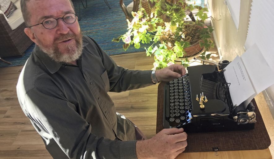 In this Feb. 21, 2017 photo, Joe Van Cleave, who runs a popular YouTube channel on restoring typewriters, speaks about one of his vintage typewriters at his home in Albuquerque, N.M. The vintage typewriter is making a comeback with a new generation of fans gravitating to machines that once gathered dust. (AP Photo/Russell Contreras)