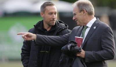 Seattle Sounders coach Brian Schmetzer, right, talks with Portland Timbers coach Caleb Porter before a U.S. Open Cup soccer match, Tuesday, June 13, 2017, in Tukwila, Wash. (AP Photo/Ted S. Warren)