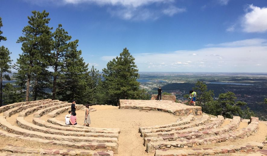 This May 13, 2017 photo shows the Sunrise Amphitheater on Flagstaff Mountain in Boulder, Colo. The circular stage with seating was built by the Civilian Conservation Corps in the 1930s and is a popular site for weddings. It offers expansive views of the city below. (AP Photo/Beth J. Harpaz)