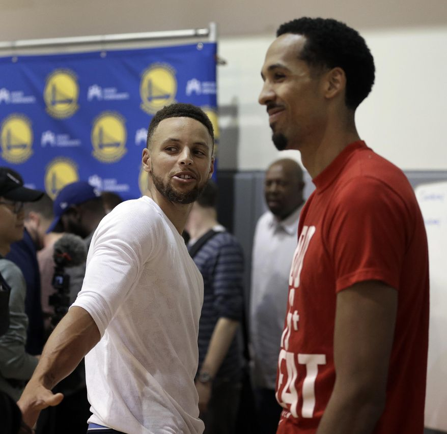 Golden State Warriors' Stephen Curry, left, and Shaun Livingston speak with reporters during a news conference Wednesday, June 14, 2017, in Oakland, Calif. The Warriors won the NBA championship over the Cleveland Cavaliers earlier in the week.. (AP Photo/Ben Margot)