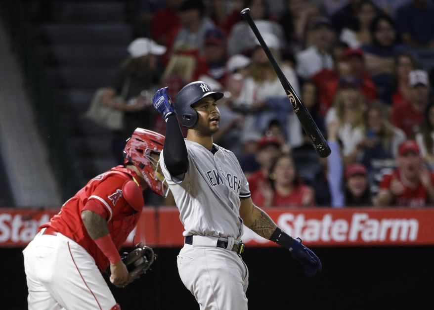 New York Yankees' Aaron Hicks tosses his bat after striking out during the fifth inning of the team's baseball game against the Los Angeles Angels, Tuesday, June 13, 2017, in Anaheim, Calif. (AP Photo/Jae C. Hong)
