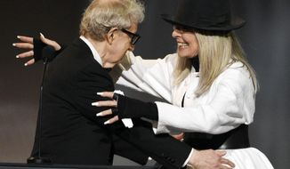 Filmmaker Woody Allen, left, greets actress Diane Keaton onstage to give her the 45th AFI Life Achievement Award during a gala tribute to her at the Dolby Theatre on Thursday, June 8, 2017, in Los Angeles. (Photo by Chris Pizzello/Invision/AP)