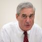 "Special counsel Robert Mueller, who this year hired a staff of 16 lawyers with significant experience prosecuting such financial crimes, is focused on unraveling the Trump family's tangled financial and real estate empire in a bid to find any connections to ""dark money"" investments from Russian oligarchs and organized crime figures, a source said. (Associated Press/File)"