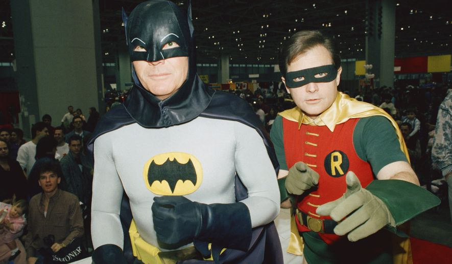 "In this Jan. 27, 1989, file photo, actors Adam West, left, and Burt Ward, dressed as their characters Batman and Robin, pose for a photo at the ""World of Wheels"" custom car show in Chicago. Los Angeles Mayor Eric Garcetti says the Bat-Signal will shine over the city on Thursday, June 15, 2017 in tribute to West, who died June 9 at the age of 88. (AP Photo/Mark Elias, File) **FILE**"