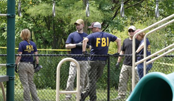 FBI agents investigate a playground near the baseball field in Alexandria, Va., Thursday, June 15, 2017, the day after then-House Majority Whip Steve Scalise of La. was shot during a congressional baseball practice at the park. (AP Photo/Jacquelyn Martin) ** FILE **