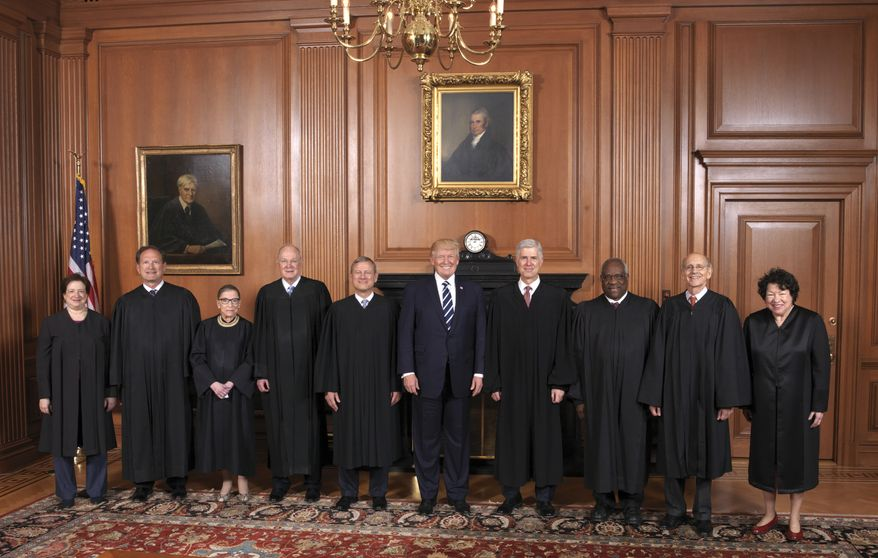 In this image provided by the Supreme Court, President Donald Trump poses with members of the Supreme Court, Thursday, June 15, 2017, at the court in Washington. From left are, Associate Justices Elena Kagan, Samuel A. Alito, Jr., Ruth Bader Ginsburg, and Anthony Kennedy, Chief Justice John Roberts, Jr., the president, Associate Justices Neil Gorsuch, Clarence Thomas, Stephen G. Breyer, and Sonia Sotomayor.  (Fred Schilling/Supreme Court via AP)    The Supreme Court held a special sitting on June 15, 2017, for the formal investiture ceremony of Associate Justice Neil M. Gorsuch. President Donald J. Trump and First Lady Melania Trump attended as guests of the Court. Members of the Supreme Court with the President in the Justices' Conference Room at a courtesy visit prior to the investiture ceremony.