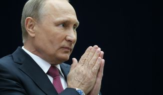 Russian President Vladimir Putin gestures speaking to the media after his annual live call-in show in Moscow, Russia, Thursday, June 15, 2017. President Vladimir Putin said Russia will pour resources into the development of its vast Arctic region for both economic and military reasons. (AP Photo/Alexander Zemlianichenko)