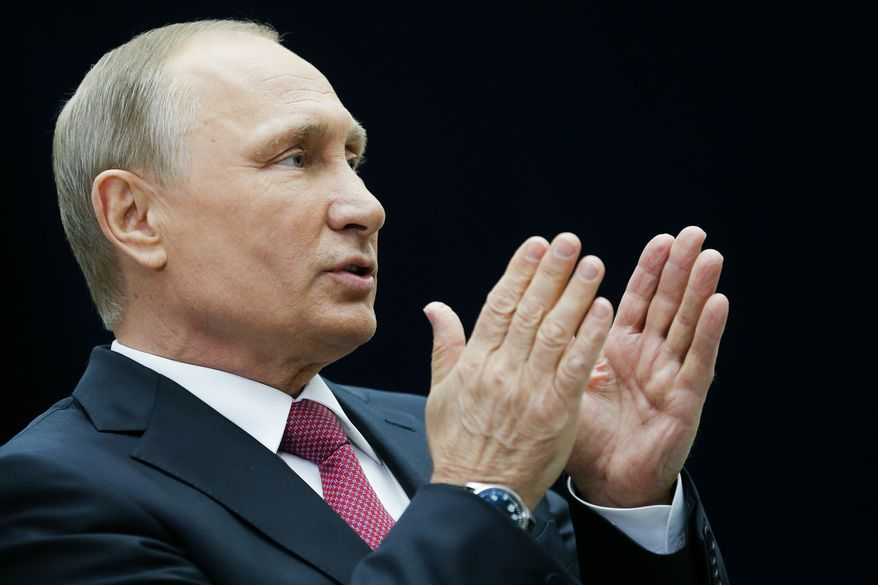 Russian President Vladimir Putin gestures while speaking to the media after his annual televised call-in show in Moscow, Russia, Thursday, June 15, 2017. The 64-year old Russian leader mixed the tough talk with benevolent promises to disgruntled callers complaining about decrepit housing and low salaries during the four-hour marathon intended to burnish his father-of-the nation image. (AP Photo/Alexander Zemlianichenko)