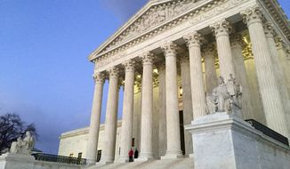 The Supreme Court at sunset is shown in this Feb. 13, 2016 file photo. On Nov. 17, 2017, the Trump White House added five judges to the president's short list for when the next vacancy on the high court's bench opens up. (AP Photo/Jon Elswick) ** FILE **