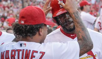 St. Louis Cardinals' Dexter Fowler, right, celebrates with teammate Carlos Martinez after hitting a solo home against the Milwaukee Brewers during the third inning of a baseball game, Thursday, June 15, 2017, in St. Louis. (AP Photo/Tom Gannam)