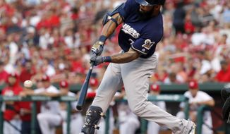 Milwaukee Brewers' Eric Thames hits a two-run home run during the first inning of the team's baseball game against the St. Louis Cardinals on Wednesday, June 14, 2017, in St. Louis. (AP Photo/Jeff Roberson)