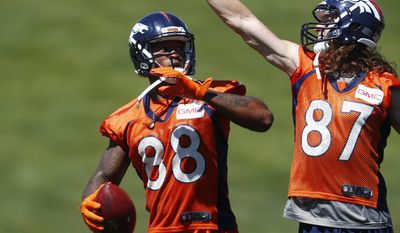 Denver Broncos wide receiver Jordan Taylor, right, tries to block a throw by wide receiver Demaryius Thomas during drills at NFL football practice, Thursday, June 15, 2017, at the team's' headquarters in Englewood, Colo. (AP Photo/David Zalubowski)