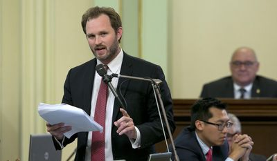 Assemblyman James Gallagher, R-Yuba City, urged lawmakers to reject the $125 billion general fund spending plan, which was negotiated by Democratic Gov. Jerry Brown and legislative leaders, during the Assembly session, Thursday, June 15, 2017, in Sacramento, Calif. (AP Photo/Rich Pedroncelli)