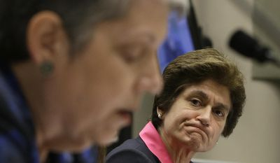 FILE -- In this Tuesday, May 2, 2017 file photo State Auditor Elaine Howle, right, looks over at University of California President Jane Napolitano reads her statement concerning the audit conducted by Howle's office, during a hearing of the Joint Legislative Audit Committee,in Sacramento, Calif. Lawmakers are expected to vote Thursday, June 15. 2017, on a state budget plan that withholds $50 million from the UC system until Napolitano's office shows it's complying with recommendations from a scathing audit of her office. (AP Photo/Rich Pedroncelli, File)
