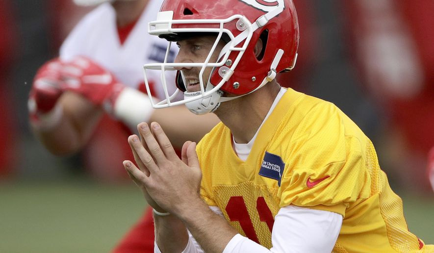 Kansas City Chiefs quarterback Alex Smith (11) participates in a drill during NFL football minicamp Tuesday, June 13, 2017, in Kansas City, Mo. (AP Photo/Charlie Riedel)