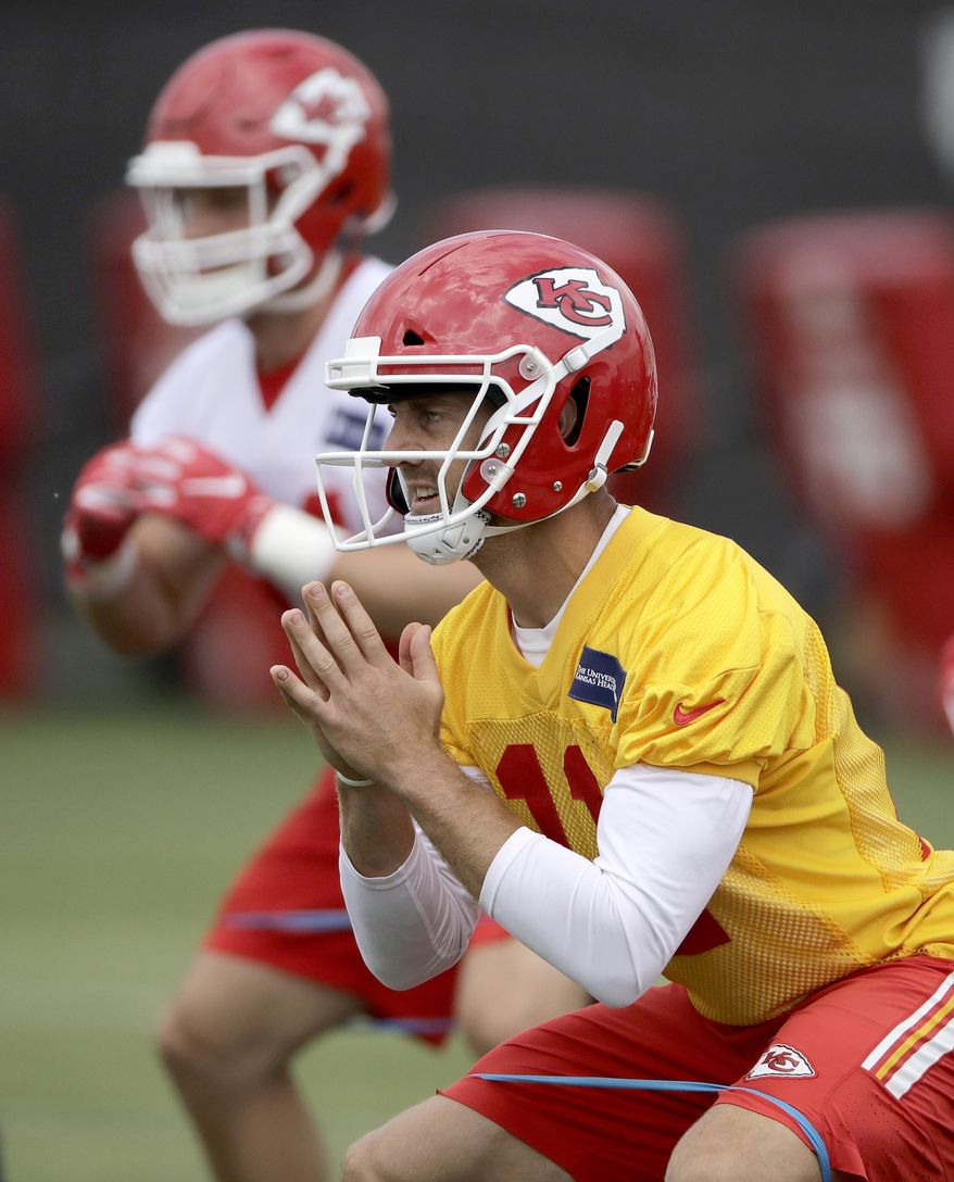 Kansas City Chiefs quarterback Alex Smith (11) participates in a drill during NFL football minicamp Tuesday, June 13, 2017, in Kansas City, Mo. (AP Photo/Charlie Riedel)