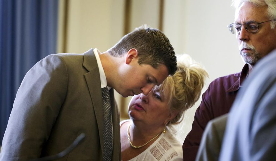 Former University of Cincinnati police officer Raymond Tensing talks to his mother, Amy Tensing, at the conclusion of his retrial, Wednesday, June 14, 2017, in the Hamilton County Courthouse in Cincinnati. Tensing is charged with murder and voluntary manslaughter in the shooting of unarmed black motorist Sam DuBose during a July 19, 2015, traffic stop.  (Cara Owsley/The Cincinnati Enquirer via AP, Pool)
