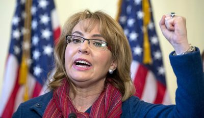 In this March 4, 2015, file photo, former U.S. Rep. Gabby Giffords, D-Ariz., speaks on Capitol Hill in Washington, about bipartisan legislation on gun safety. (AP Photo/Carolyn Kaster, File)