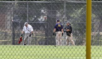 FBI agents continue to search for evidence on the baseball field in Alexandria, Va., Thursday, June 15, 2017, the day after House Majority Whip Steve Scalise of La. was shot during during a congressional baseball practice. (AP Photo/Jacquelyn Martin)