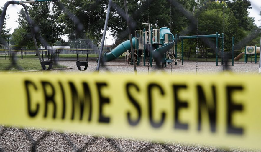 A playground near the baseball field is cordoned off with police tape as the investigation continue at the scene in Alexandria, Va., Thursday, June 15, 2017, the day after House Majority Whip Steve Scalise of La. was shot during during a congressional baseball practice. (AP Photo/Jacquelyn Martin)