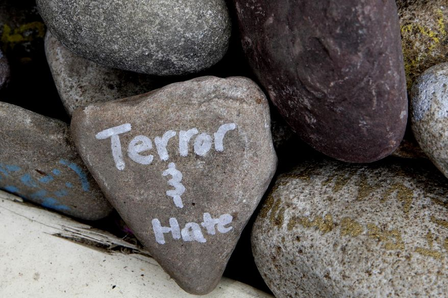 """A rock has the words """"terror and hate"""" written on it at an art installation that encourages the public to write out their fears and leave them behind, along Mt. Vernon Ave in Alexandria, Va., Thursday, June 15, 2017, the day after House Majority Whip Steve Scalise of La. was shot during during a congressional baseball practice. (AP Photo/Jacquelyn Martin)"""