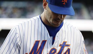 New York Mets starting pitcher Matt Harvey steps into the dugout during the first inning of the team's baseball game against the Chicago Cubs on Wednesday, June 14, 2017, in New York. (AP Photo/Frank Franklin II)