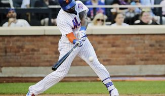 New York Mets' Jose Reyes hits an RBI single during the second inning of the team's baseball game against the Chicago Cubs on Wednesday, June 14, 2017, in New York. (AP Photo/Frank Franklin II)