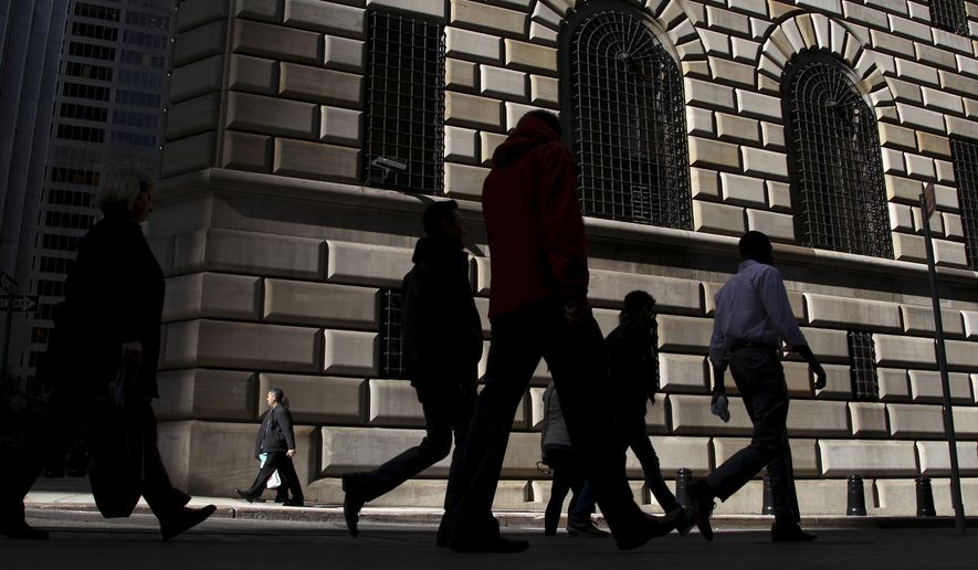 FILE - In this Thursday, Oct. 18, 2012, file photo, pedestrians walk past the Federal Reserve Bank of New York, in New York. On Thursday, June 15, 2017, the Federal Reserve of New York releases its June survey of manufacturers in the state. (AP Photo/Seth Wenig, File)