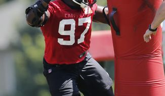 Atlanta Falcons defensive tackle Grady Jarrett (97) works on his pass rushing skills during NFL football minicamp, Thursday, June 15, 2017, in Flowery Branch, Ga. Jarrett, who is the son of former Falcons' linebacker Jessie Tuggle, had three sacks in the Super Bowl. (AP Photo/John Bazemore)