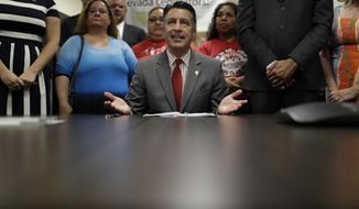 Nevada Gov. Brian Sandoval speaks before signing Senate Bill 539 during a signing ceremony Thursday, June 15, 2017, in North Las Vegas, Nev. The bill aims to force America's three insulin manufacturers to annually turn over the prices they set and profits they make on insulin. (AP Photo/John Locher)