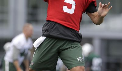 New York Jets quarterback Christian Hackenberg throws a pass during NFL football practice, Thursday, June 15, 2017, in Florham Park, N.J. (AP Photo/Julio Cortez)