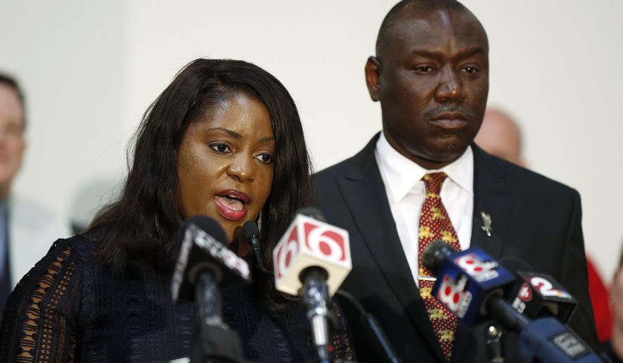 FILE- In this May 18, 2017, file photo, Tiffany Crutcher, sister of Terence Crutcher, and Benjamin Crump speak during a press conference in Tulsa, Okla., after a not guilty verdict in the manslaughter trial of Betty Shelby, a white Oklahoma police officer who fatally shot Terence Crutcher, an unarmed black man. The family of Terence Crutcher filed a wrongful death lawsuit in federal court Thursday, June 15, against the city of Tulsa and the policewoman, who was acquitted of manslaughter charges last month. (Stephen Pingry/Tulsa World via AP, File)
