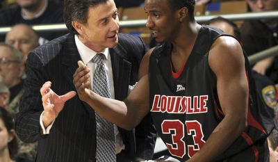 FILE - In this Feb. 12, 2009, file photo Louisville coach Rick Pitino, left, talks with guard Andre McGee during the first half of an NCAA college men's basketball game against Notre Dame in South Bend, Ind. The NCAA suspended Pitino, Thursday, June 15, 2017, for five ACC games following sex scandal investigation. A former men's basketball staffer is alleged to have hired strippers to entertain players and recruits. In addition, the governing body also placed the basketball program on four years' probation, vacated wins in which ineligible players participated and handed down a 10-year show-cause order for former basketball operations director Andre McGee. (AP Photo/Joe Raymond, File)