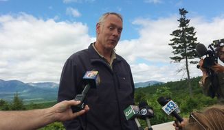 "Interior Secretary Ryan Zinke talks with reporters with part of Mount Katahdin in the background at the Katahdin Woods And Waters National Monument near Staceyville, Maine, Wednesday, June 14, 2017. Zinke praised the beauty of the national monument Wednesday and said he's ""comfortable"" with the National Park Service property remaining in public hands. (AP Photo/Patrick Whittle) ** FILE **"