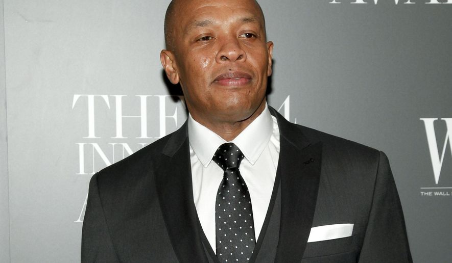 FILE - In this Nov. 5, 2014 file photo, Dr. Dre attends the WSJ. Magazine 2014 Innovator Awards at MoMA in New York. Dr. Dre is pledging $10 million toward the construction of a performing arts center at Compton High School. The Compton Unified School District said Thursday, June 15, 2017, that the producer will help raise additional funds for the new facility, which is expected to break ground in 2020. (Photo by Andy Kropa/Invision/AP, File)