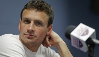 FILE - In this May 12, 2016, file photo, Ryan Lochte listens to a question from the media in Charlotte, N.C. Lochte shared a photo of his newborn son June 14, 2016 on Instagram. (AP Photo/Chuck Burton, File)