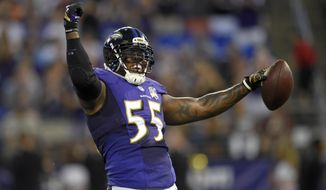 FILE - In this Aug. 29, 2015, file photo, Baltimore Ravens outside linebacker Terrell Suggs celebrates after intercepting a pass attempt by Washington Redskins quarterback Kirk Cousins during a preseason NFL football game in Baltimore. Don't let Suggs' mischievous smile and devil-may-care demeanor fool you. Underneath all that is a serious football player, one who stands out as the unquestioned leader of the Ravens defense. (AP Photo/Nick Wass, File)